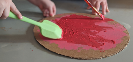 Red paint on cardboard